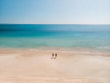 Aerial View Of A Couple Walking On Rainbow Beach, Queensland, Australia.