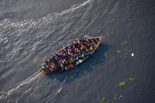Aerial View Of A Wooden Ferry Boat Full Of Passengers Sailing Across The Shitalakshya River In Bandar, Dhaka Division, Bangladesh.
