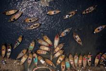Aerial View Of Traditional Boats Docked At Old Dhaka River Port Along Buriganga Shoreline River In Dhaka, Bangladesh.