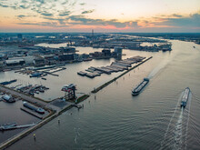 Aerial View Of City Harbour With Boats Docked At Sunset Along Buiten IJ Canal In Amsterdam, North Holland, Netherlands.