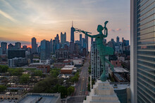 Aerial View Of Chicago Skyline At Sunset, View Of Financial District Downtown With A Marble Statue In Foreground, Chicago, Illinois, United States.