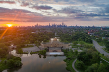 Aerial View Of Garfield Park Gold Dome Field House In Garfield Park With City Downtown In Background At Sunset, Chicago, Illinois, United States.