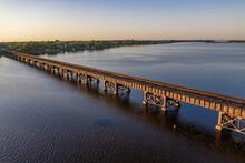 Aerial View Of A Railroad Bridge Crossing Saint Sebastian River In Sebastian, Florida, United States.