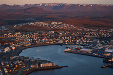Aerial View Of A Small City Port With Residential Building And Mountains In Background At Sunset, Reykjavík, Iceland.