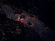 Aerial View Of Lava Streaming Down The Mountain Ridge, View Of A River Of Lava Flowing From The Craters In Grindavík, Southern Peninsula, Iceland.