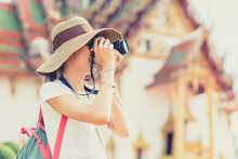 Girl Teen Travel In Thailand. Tourist Take A Photograp In Temple In Asian Country Vintage Leisure Lifestyle In Holiday.