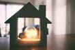 Leinwandbild Motiv Wood house with Light bulb. energy concept or invention