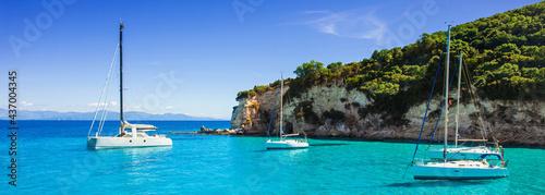 Fotografia Beautiful bay with sailing boats, Paxos island, Greece
