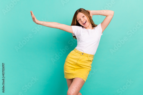 Fotografie, Obraz Photo portrait girl dancing at party overjoyed relaxing in casual outfit isolate