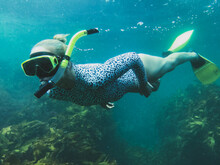 Woman Snorkelling Over Reef And Coral