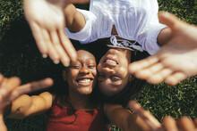 Happy Black Women Lying On Grass