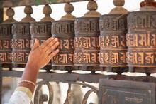 Hand Turning Prayer Wheels At The Swayambhunath Stupa In Kathmandu