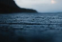 Rippled Sea Against Mount Under Cloudy Sky At Sundown
