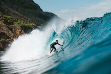 Surfer Practicing Surfing On Wavy Sea With Splashing Water