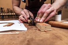 Crop Luthier Cutting Wooden Piece With Plane In Workroom