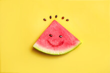 Ripe Juicy Watermelon Piece With Funny Face On Yellow Background. Top View.