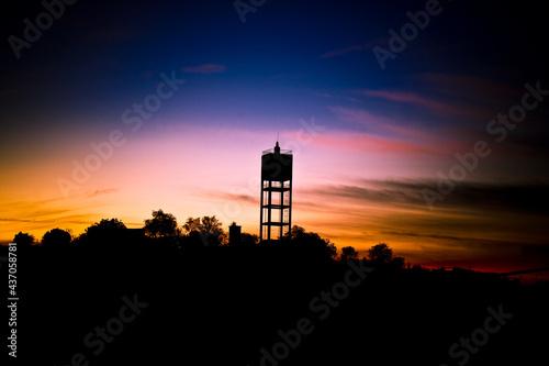 Fototapeta sunset in water tower soudos Portugal santarem