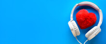 White Wired Headphones And Red Heart On A Blue Background. Entertainment Concept. Banner