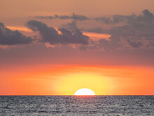 Sun In Orange Sky At Sunset Over The Gulf Of Mexico Off Venice, Florida USA