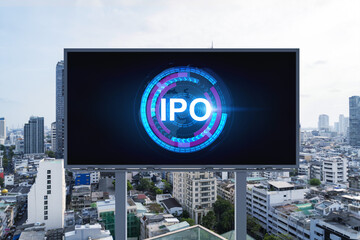 IPO icon hologram on road billboard over day time panorama city view of Bangkok. The hub of initial public offering in Southeast Asia. The concept of exceeding business opportunities.