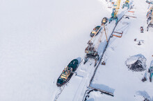 Ice Bound Frozen Port For Transshipment Of Coal From Polar Mines Container Cargo Ship Loading North Arctic Doc, Top Aerial View