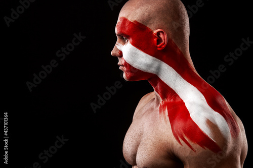 Fototapeta premium Austria fan. Soccer or football athlete with flag bodyart on face. Sport concept with copyspace.