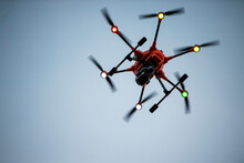 Yuneec H520 RTF Hexacopter Drone With Thermal Imager Hovering Above Viewer In Dusk Sky, Motion Blurred Propellers