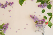 Lilac And Purple Flowers In A Shopping Basket.  On A Yellow Background Concept, Summer Discounts, Sale. There Is A Place For Text