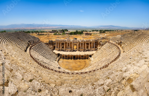 Hierapolis, Pammukale, Turkey. Ancient amphitheater. Panoramic landscape in the daytime. UNESCO Heritage Site. Historic Site. A vacation and tourism destination. #437109370