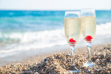 Glasses With Champagne On The Sea. Copy Space