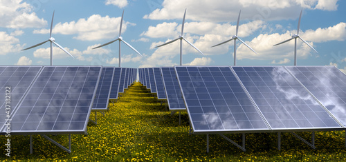 Photovoltaic panels and windmills in a meadow of blooming dandelions #437182122