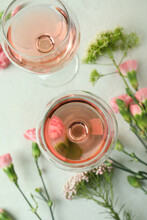 Glasses Of Pink Wine And Beautiful Flowers