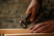 Carpenter Pulling The Nail With Carpenters Pincers.