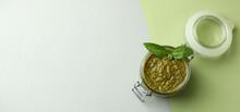 Jar Of Pesto Sauce On Two Tone Background