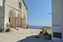 Ravello, Italy, May 19, 2017. The Portico Of A Small Church With A Panoramic View Of The Mountains Of The Amalfi Coast.