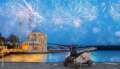Canvas Ortakoy mosque and Bosphorus bridge with  pink fireworks at twilight blue hours