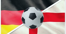 Composition Of Football Over German And English Flag Background