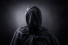 Creepy Figure Over Dark Misty Background