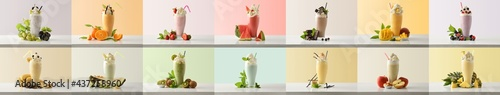 Set of various flavors milkshakes decorated with fruits colored background