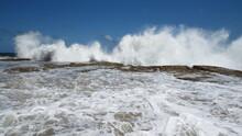 Wave Burst On Rockpool