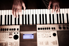 Close-up Of A Music Performer's Man Hands Playing The Electric Piano. Top View
