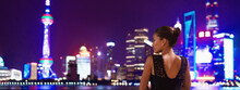 Luxury Shanghai Travel China Lifestyle. Elegant Rich Chinese Asian Woman Model Going Out In City Nightlife Looking At Skyline Vew Panoramic Landscape.