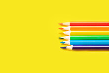 Crayons Concept Closeup Of Various Colors, Rainbow Color Selection, Equality Or LGBT Gay Pride Flag Or Beautiful Life Concept On Yellow Background