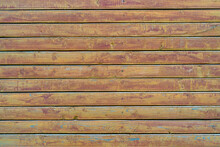 Old Wood Vintage Planks Covered With Flaky Brown Paint.