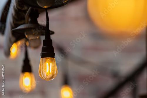 Yellow lightbulbs hanging in downtown Fort Myers Fototapeta