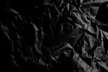 Crumpled Black Paper. Dents. Black Background. Cracks