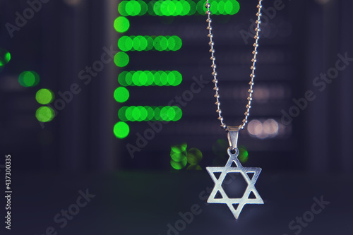 Fotografie, Tablou High tech and Jewish religious symbol on a bokeh background from lamps of server