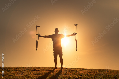 Man letting go of crutches able to walk again Fotobehang