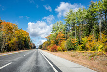 Landscape With A Skyline Abutting Highway With Picturesque Autumn Maple Trees In New Hampshire New England