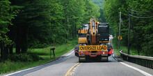 A Truck Carrying An Oversize Load Is Heading Toward An Oncoming Car On Route 79 In The Small Town Of Windsor In Broome County In Upstate NY. Taking Up 2 Lanes Of Rural Road.